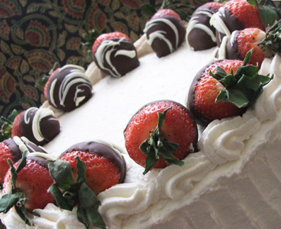 this was a birthday cake for a recipient who likes strawberries,